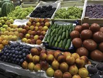 Fruit and vegetable stand. Fruit and vegetable Market stand With grapes, peaches plums and cucumbers among others Royalty Free Stock Photography