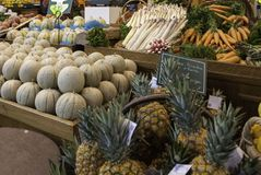 Fruit and vegetable stand. With melons and pineapples Royalty Free Stock Photo