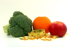Fruit , vegetable, supplement and measure tape. Healthy Life. Broccoli,orange,apple,fish oil,measure tape Stock Photo