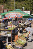 Fruit and vegetable vendors with local shoppers at an outdoor market, Jablanica, Bosnia and Herzegovina Stock Photography