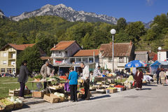 Fruit and vegetable vendors with local shoppers at an outdoor market, Jablanica, Bosnia and Herzegovina Stock Photos