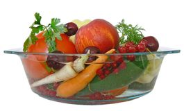 Fruit and vegetables 1. Some fruits and vegetables rinsed in a bowl of water Royalty Free Stock Photography