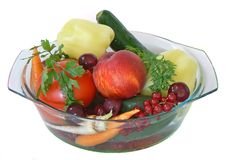 Fruit and vegetables 1. Some fruits and vegetables rinsed in a bowl of water Royalty Free Stock Image