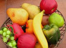 Fruit and vegetables. Plastic fruit and veggies in bowl royalty free stock images