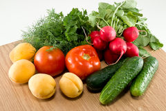 Fruit and Vegetables. Apricots radish greens tomato cucumber Royalty Free Stock Photo