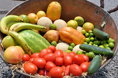 Fruit and Vegetables. Some Fruits and vegetables at a copper pot Royalty Free Stock Photography