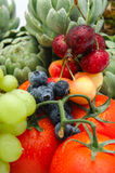 Fruit and Vegetables. Freshly rinsed in season fruit and vegetables with Artichokes, tomato, blueberries, Bing Cherries and Rainier Cherry Royalty Free Stock Images