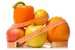 Fruit and vegetables apple grapefruit lemon centimeter losing weight. On white background isolation Stock Image