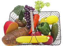 Fruit vegetables bread basket isolated Stock Photography