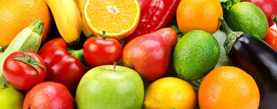 Fruit and vegetables. Bright background of ripe fruit and vegetables Stock Photos