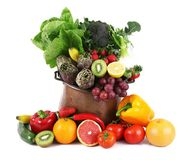 Fruit and vegetables collage on pot on white background royalty free stock images