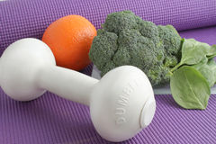 Fruit and vegetables with exercise equipment Royalty Free Stock Photos