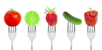 Fruit and vegetables on forks Royalty Free Stock Images