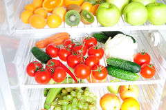 Fruit and vegetables in the fridge Royalty Free Stock Image