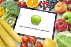 Fruit Vegetables Healthy Diet Tablet App. A computer tablet surrounded by fresh fruit and vegetables. Please see similar image no.27176595 as well Stock Images