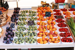 Fruit and vegetables on market stall. A selection of fruit and vegetables on a French market stall in Nice France Royalty Free Stock Photos