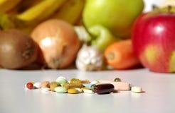 Fruit, vegetables, or medicines ? Stock Photo