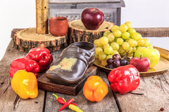 Fruit and vegetables on an old wooden table Stock Images