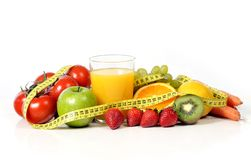 fruit , vegetables and orange juice in measure tape Royalty Free Stock Image