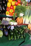 Fruit and vegetables for sale at the market with the price tag Stock Images