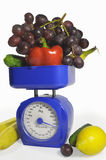 Fruit and vegetables on scales Royalty Free Stock Photos
