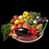 Fruit and vegetables tray - black background Royalty Free Stock Photos