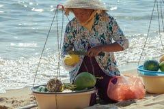 Fruit vendor on the beach of Phu Quoc Island. Popular tourist destination, Southern Vietnam stock photo