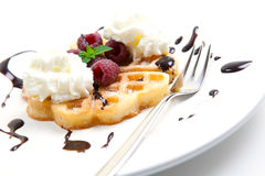 Fruit waffle and cream. Waffle with fruit, cream and choclate sauce Royalty Free Stock Photos