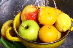 Fruit washing Royalty Free Stock Images