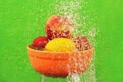 Fruit in water. Stock Photos