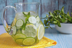 Fruit water in glass pitcher. Fruit water with lemon, lime, cucumber and mint in glass pitcher stock images