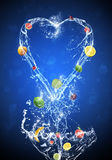 Fruit In Water Splash Blue Background Royalty Free Stock Photos