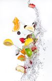 Fruit with water splash Stock Photos