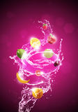 Fruit In Water Splash Red Background Royalty Free Stock Photos