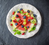 Fruit watermelon pizza with fresh berries and mint Royalty Free Stock Image