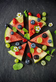 Fruit watermelon pizza with fresh berries and mint Stock Images