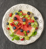 Fruit watermelon pizza with fresh berries and mint Royalty Free Stock Photos