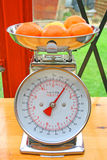 Fruit on weighing scales. Stock Photo