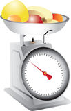 Fruit on weighing scales Stock Images