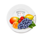 Fruit on the weight scale. Diet concept. Royalty Free Stock Photo
