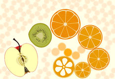 Fruit wheels. Apple, kiwifruit and orange slices presented as live clockwork cogwheels Stock Photo