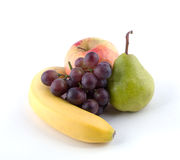 Fruit on a white background. Banana,  apple, pear, grapes on a white background Royalty Free Stock Photos