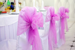 Wedding chair with bow. Pink big bow wedding decoration of the hall Stock Photo