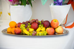 Fruit on on white. Dessert on a platter. Royalty Free Stock Photo