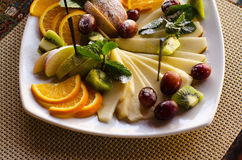 Fruit  on a white plate. Stock Images
