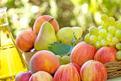Fruit and white wine Stock Images