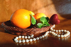 Fruit on wicker a plate royalty free stock photos