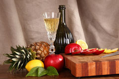 Fruit and wine on a chopping board Royalty Free Stock Photography