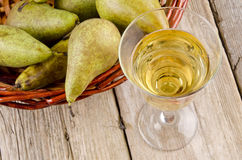 Fruit wine in a glass and fresh pears Royalty Free Stock Photography