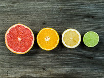 Fruit on wood background in a row Royalty Free Stock Photos
